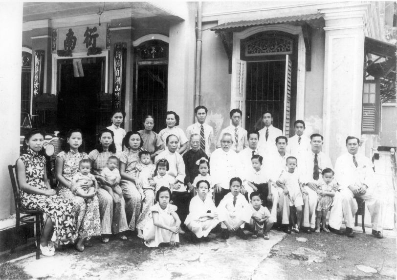 A 1940s Chinese New Year photo of Lam family members. Squatting in the forefront (first from right) is the writer