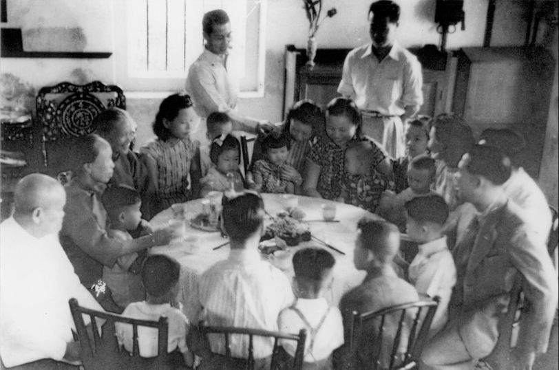 The Lam family having tea and Chinese New Year titbits in the early 1940s