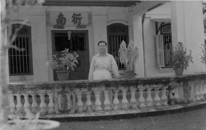 The writer's father in the front porch of their bungalow