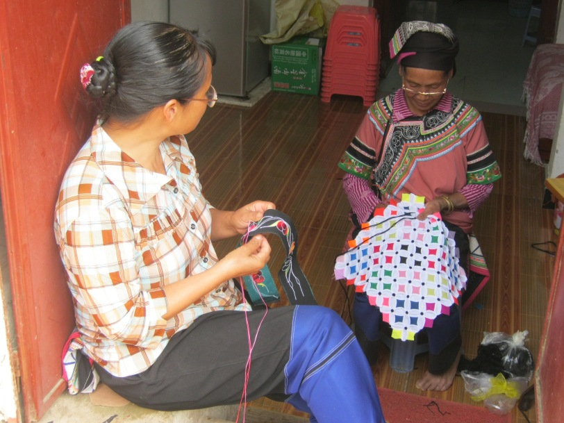 Women busy at sewing, Yunnan Province, 2013